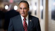 Indicted Republican Rep. Chris Collins suspends re-election campaign