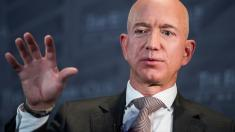 Bezos says Enquirer threatened to publish revealing pics