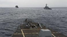 US sails 2 warships past disputed island chain in South China Sea