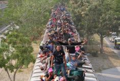 Hundreds of migrants in southern Mexico board 'The Beast' heading north