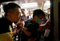Commuter chaos as protesters seek to shut Hong Kong with general strike