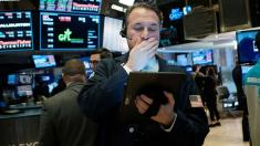Markets swing as investors await news of coronavirus economic relief
