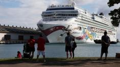 Troubled cruise ship with 2,000 passengers docks in Honolulu