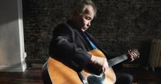 John Prine still hospitalized with COVID-19 but is now stable, his wife says