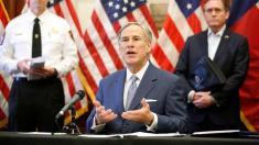 Texas governor sued over blocking bail to those trying to avoid coronavirus