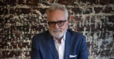 Bradley Whitford, architect of disturbing dystopian future? Yes, and he sings too