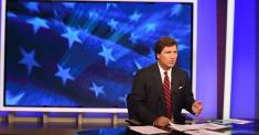 Tucker Carlson criticizes racist comments of show writer but offers no apology