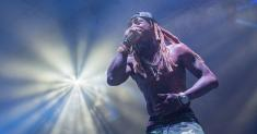 Lil Wayne charged with possession of a firearm by a convicted felon