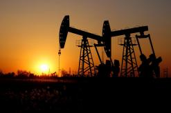 Oil prices up above 1 percent on strong U.S. economic data, Libya supply risks