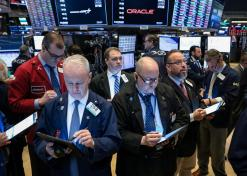 Wall Street ekes out gains as investors shrug off Fed minutes