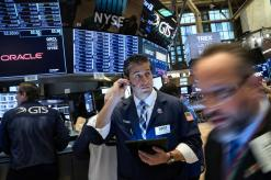 Wall Street edges higher on generally upbeat earnings