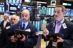 Wall Street slumps at open as trade worries return