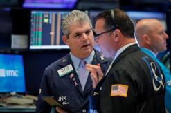 Stocks, yields tumble as trade frictions unnerve traders