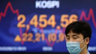 Asian shares mixed, led by Tokyo gains, after Wall St rally