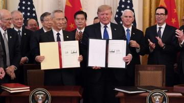 President Trump signs partial trade deal with China, calling it a 'momentous step'