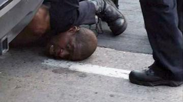 Protesters clash with police following death of black man seen pinned down in video