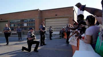 Oklahoma deputies take a knee in solidarity, hug protesters demanding justice for George Floyd