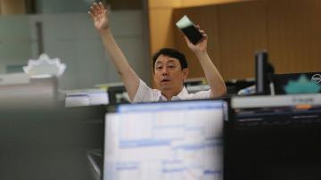 Asian stocks follow Wall Street higher after tech gains
