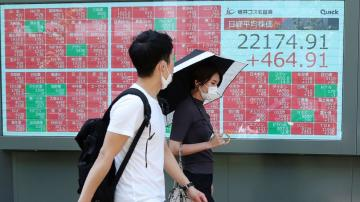 Asian shares mixed on US-China tensions, Wall Street gains