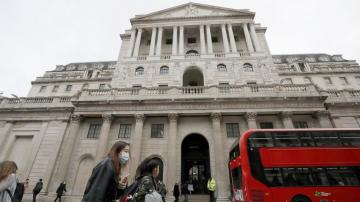 Bank of England holds off more stimulus, sees slow recovery