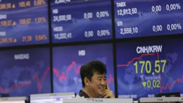 Asian shares skid amid virus woes, China-US trade tensions