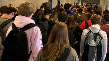 The Georgia student who posted the image showing a packed hallway and few visible masks was suspended