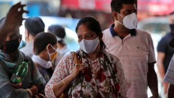 Asia Today: India has record spike of 95K new virus cases