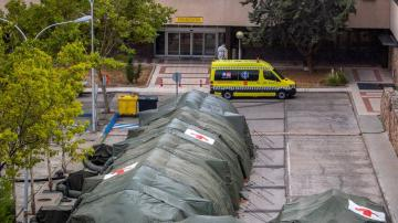 Emergency tents, restrictions back as virus spikes in Madrid