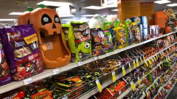 Americans load up on candy, trick or treat - or not