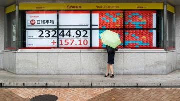 Asian shares mixed, cheered by US rally, stimulus hopes