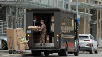 With brown trucks everywhere, UPS delivers again in 3Q