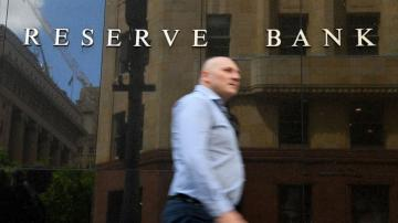 Australian central bank cuts key interest rate to 0.1%