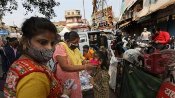 India virus cases pass 9M; capital's hospitals under strain