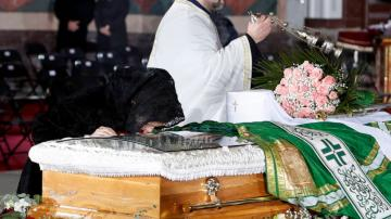 Serbian patriarch buried with few virus measures in place