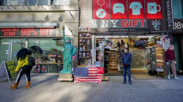 Tourists few, NY gift shops struggle but don't lose (heart)