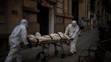 Spain's mortuary workers endure the daily march of death