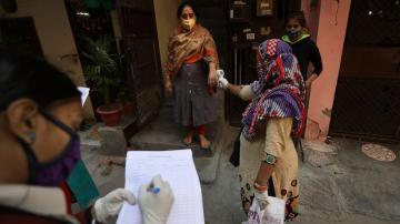 The Latest: India's capital mulls curfew amid virus surge