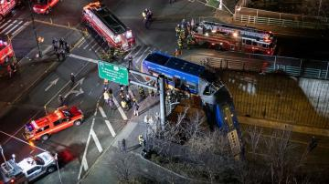 9 injured after NY passenger bus drives off overpass in the Bronx, is left hanging
