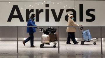 UK eyes quarantine hotels for travelers to curb variants