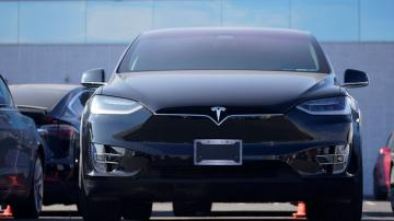 Tesla fights pandemic, rides sales jump to 1st annual profit
