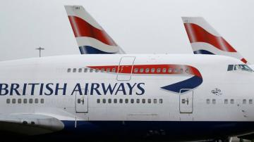 BA parent company books huge loss, pushes for digital passes