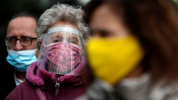 Alarm grows in Serbia over virus surge; lockdown urged