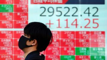 Asian shares advance despite Wall Street retreat