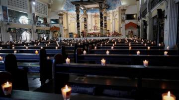 The Latest: No crowds at Holy Week ceremonies amid pandemic