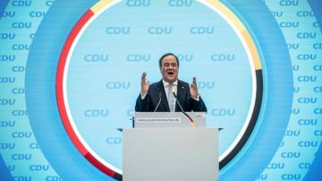 Leader of Merkel's party vows to boost German voters' trust