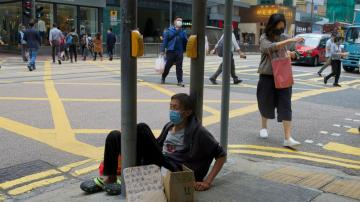 The Latest: Hong Kong to ease some travel, social limits