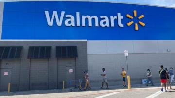 To retain workers, Walmart moves more of them full time
