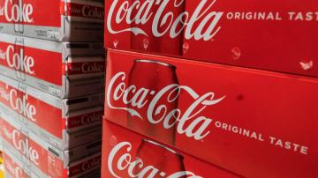 Coca-Cola sales rise as vaccinations roll out, venues open
