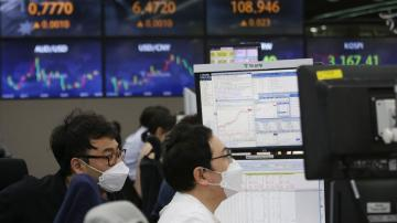Asian shares slip on pandemic worries despite Wall St rally