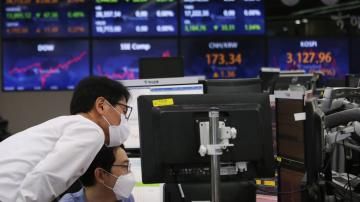 Asian shares higher after strong earnings, data lift Wall St